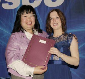 Ada Cheung giving Vanessa Campbell an Award