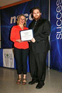 Monica Lloyd giving Evan Brant an award.