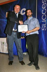 Jim Norton giving award to Ryan Porier